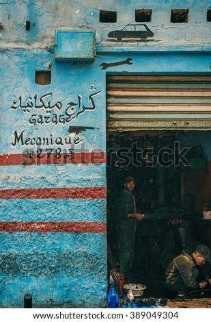 CASABLANCA, MOROCCO - FEBRUARY 1 2014: Mechanics in the workshop repair a car - stock photo
