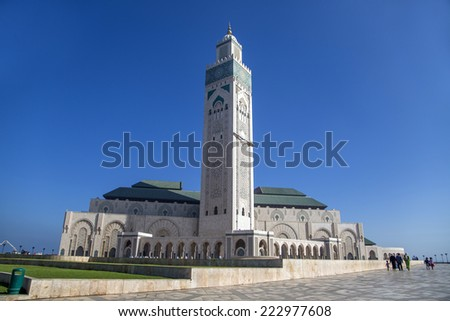 CASABLANCA, MOROCCO - SEPTEMBER 10, 2014: Unidentified people by Mosque Hassan II in Casablanca, Morocco. Hassan II Mosque is the largest mosque in Morocco and Africa and the 7th largest in the world.