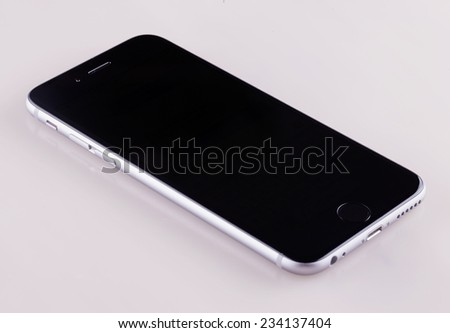 CASALE MONFERRATO, ITALY - NOVEMBER 28, 2014: Apple iPhone 6, front view, lying on white background. iPhone 6 is the latest model of successful dynasty of smartphones - stock photo