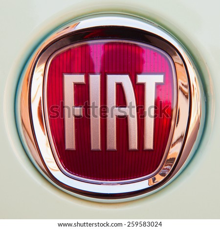 CASALE MONFERRATO, MARCH 10, 2015: Fiat symbol over green car. Fiat is a subdivision group of great autumobiles group FCA. - stock photo