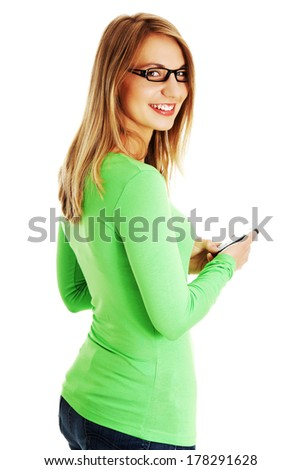 Casaual young woman using cellphone. Isolated on white - stock photo