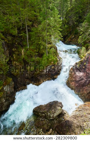 Cascade green forest waterfall stream water river Tatra mountains Carpathians - stock photo