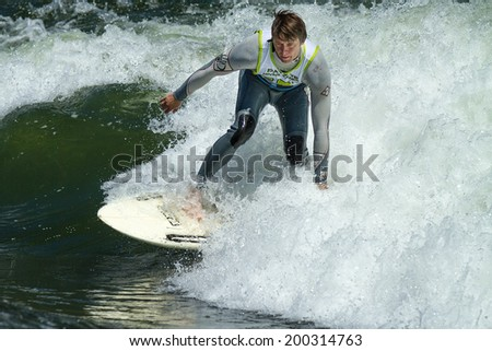 CASCADE, IDAHO/USA - JUNE 21, 2014: Surfer gets some time on the river wave during the Payette River Games.