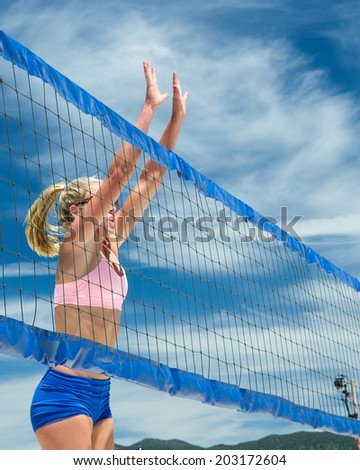 CASCADE, IDAHO/USA - JUNE 21, 2014:Woman jumps up to try to block the shot at the Payette River Games in Cascade, Idaho