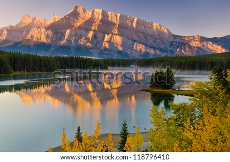 Cascade Mountain reflecting over Two Jack Lake in Banff National Park - stock photo