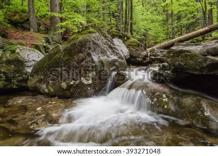 Cascade on the river in Bohemia - stock photo