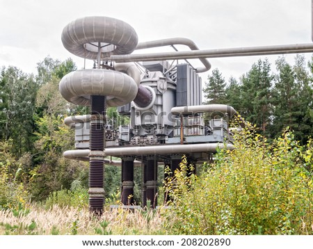 Cascade Transformer (3 MV) of High-Voltage Research Centre Testing Stand against forest background.  - stock photo