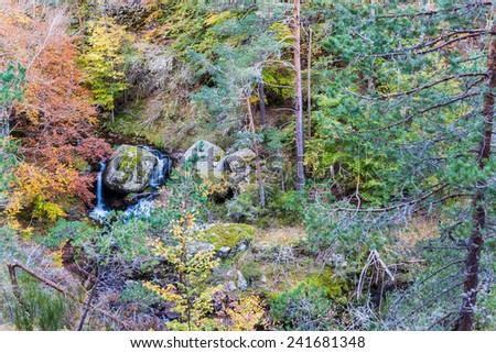 Cascades of a stream Puente Ra, natural park Sierra de Cebollera, Spain - stock photo