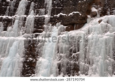 Cascades of ice in cliff of Appalachian Mountains in Pennsylvania - stock photo