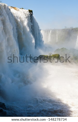 Cascades of water large, vertical frame, Iguassu Falls, Brazil