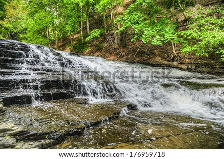 Cascadilla Falls is a 20 foot multiple cascading fall in Ithaca, New York. A part of the Finger Lakes region. - stock photo