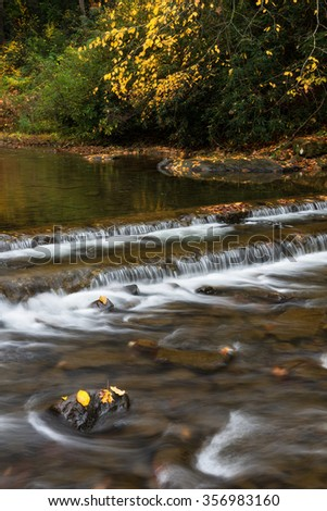 Cascading water and fall foliage in Southwestern Virginia - stock photo