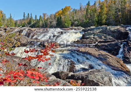Cascading water over rocks in Superior Lake Provincial park, Canada - stock photo