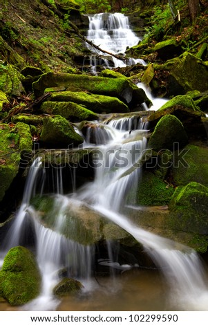 Cascading waterfall during spring located in Oil Creek State Park. - stock photo