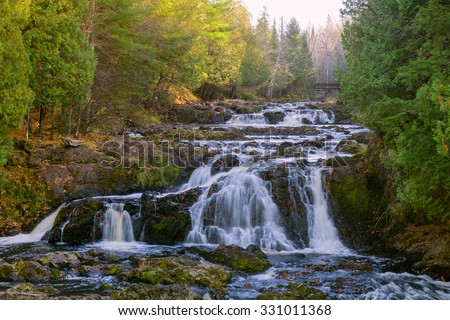 Cascading waterfalls located in Copper Falls state park Wisconsin. - stock photo