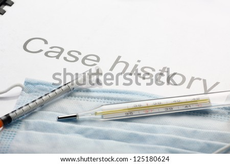 Case history, mask, syringe and thermometer
