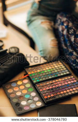 Case makeup artist. A set of brushes, powder, foundation. Tools make-up artist in a box