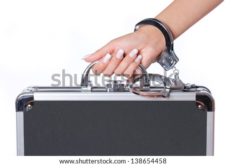 case of money in female hand with handcuffs, isolated on white. concert - stock photo