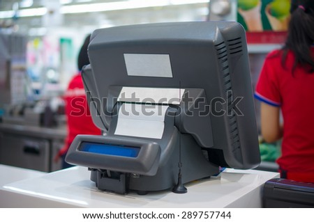 Cash desk with computer terminal in cafe - stock photo