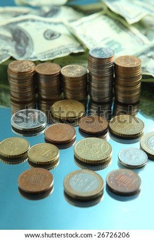 Cash dollars and pile of coins - stock photo
