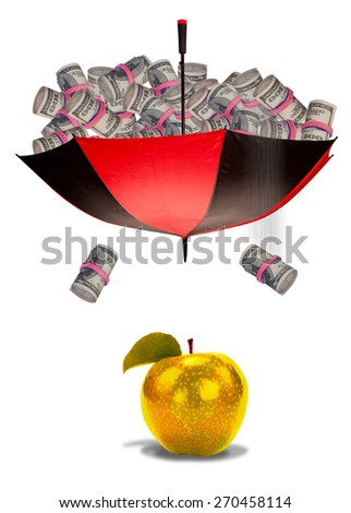 Cash falling from umbrella on to golden apple. - stock photo