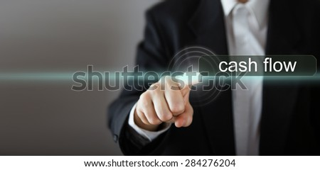 """Cash flow. Businessman's hand pressing the icon with text """"Cash flow"""" on virtual screens. Business, technology, internet and networking concept. Copy space - stock photo"""