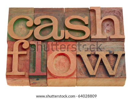 cash flow words in vintage wooden letterpress type isolated on white