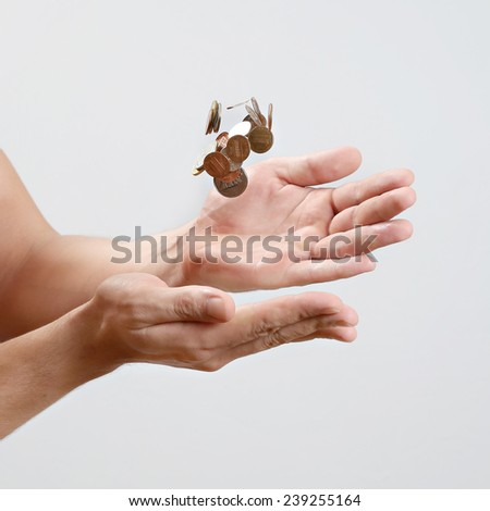 Cash , Hand catching falling coins - stock photo