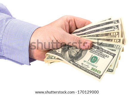 Cash in hand of businessman over white - stock photo