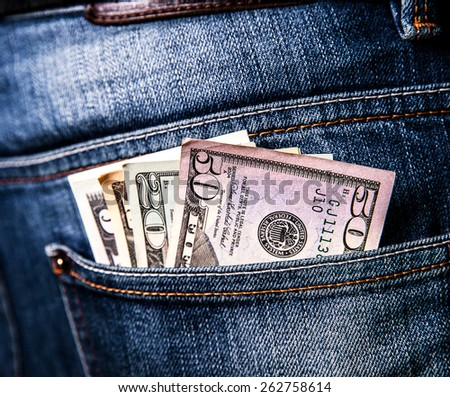 cash in your pocket. money in dollars - stock photo