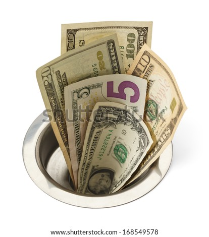 Cash Money Going Down Sink Drain Isolated on White Background. - stock photo