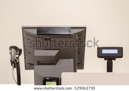 cash registers, bar code reader and monitor turn from the back
