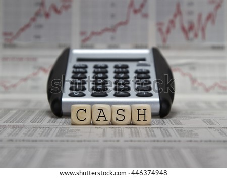 Cash word on a business newspaper background