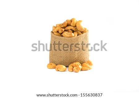 Cashew nuts in a sack with isolated white background