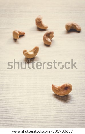 cashew nuts on wooden background, Vintage picture