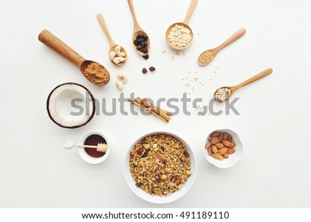 Cashew nuts, raisins, oats, honey, coconut, almonds, cinnamon, and seeds