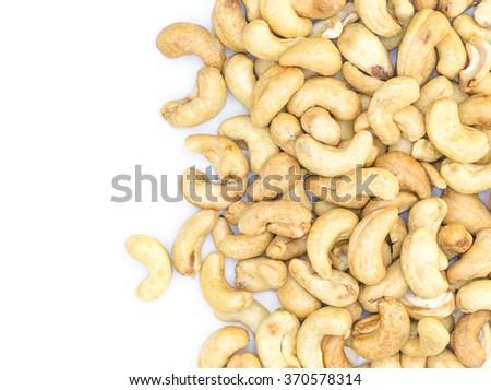 Cashews nut heap on white background - stock photo