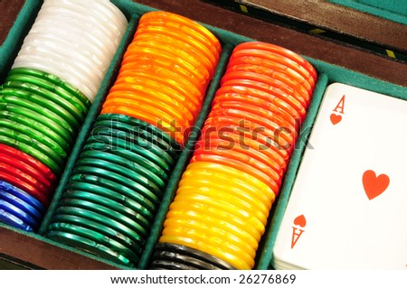 Casino chips and playing cards - stock photo