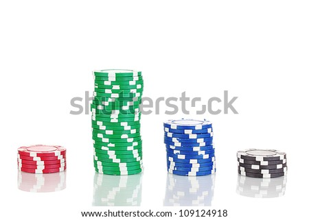 Casino chips isolated on white - stock photo