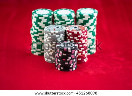 casino chips on red cloth