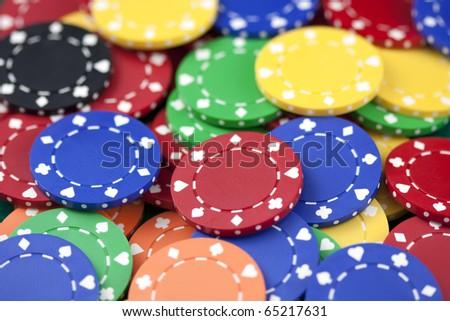 Casino chips, red, yellow, green, orange, black - stock photo