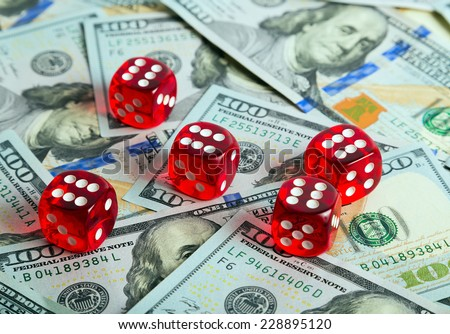 Casino dices Close up on us dollar bill background - stock photo