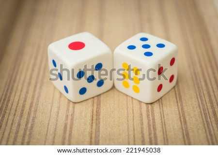 Casino dices on a wooden - stock photo