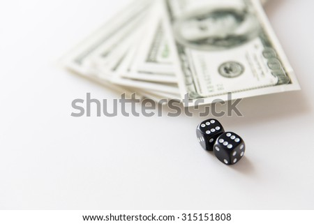 casino, gambling and fortune concept - close up of black dice and dollar cash money - stock photo
