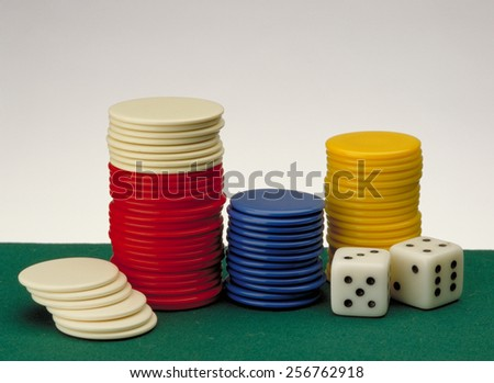 Casino gambling background and Poker Chips on a gaming table. - stock photo