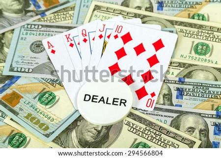 Casino gambling chips and playing cards in us dollar background