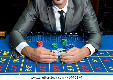 casino games with gambler hands - stock photo