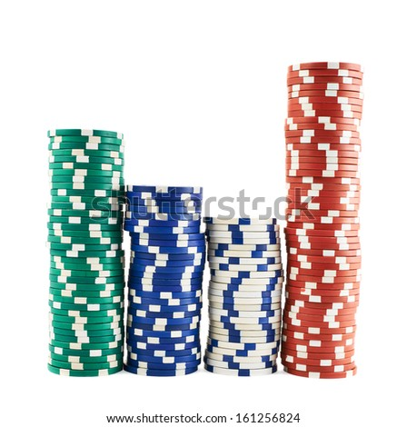 Casino playing chips stacks isolated over white background - stock photo