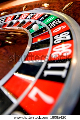 casino roulette close up with the ball on number zero - stock photo