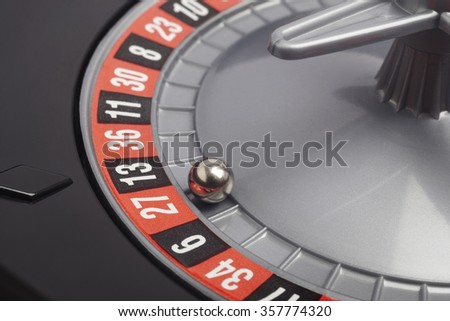 Casino roulette detail with ball in number twenty seven. Gambling. Horizontal
